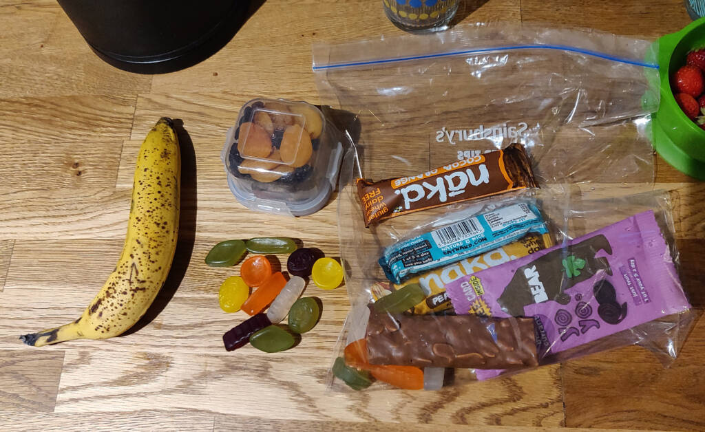 Assortment of foods being sorted out for ultra trail running preparation.