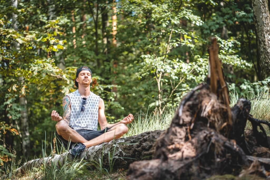man meditating during a trail run