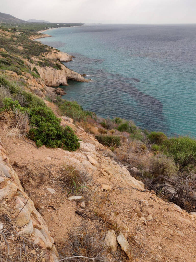 Running a trail on the cliff edges in the south of Sardinia, Italy