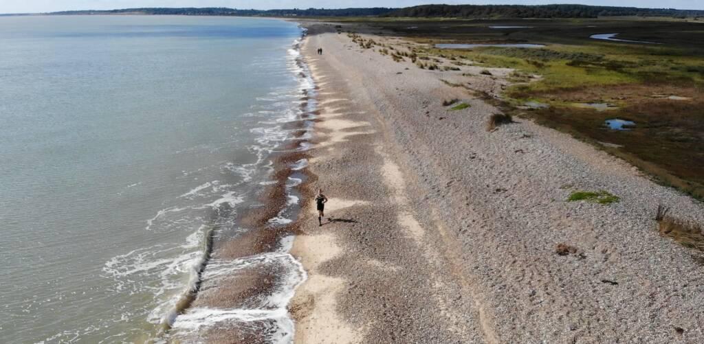 coastal trail running near Dunwich, Suffolk. A view of the beach from the air, taken by DJI Mavic Air quad copter.