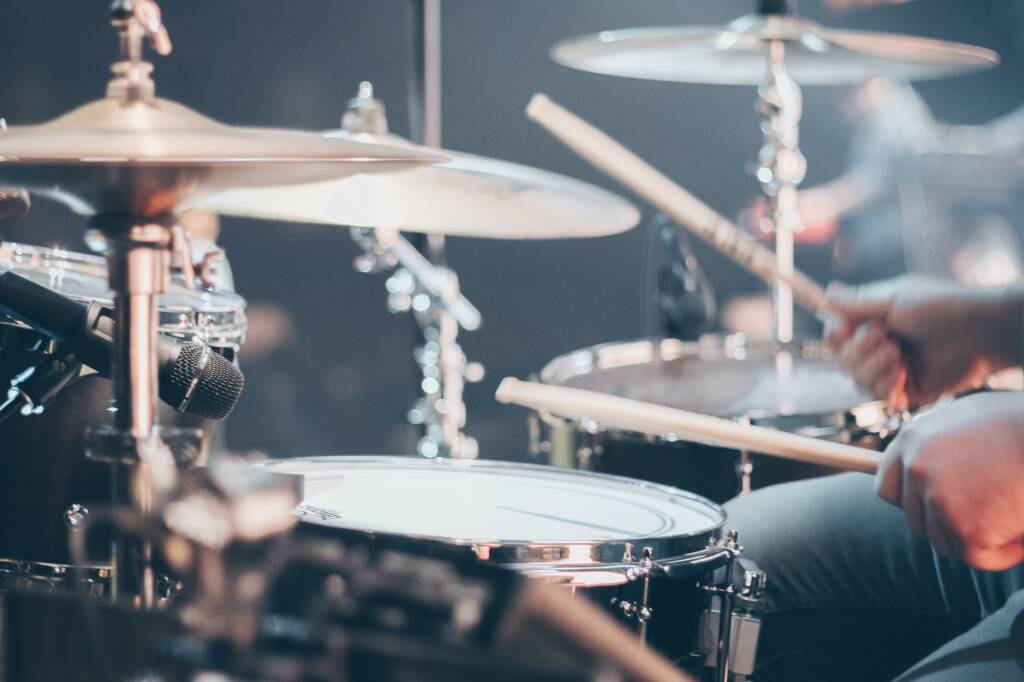 drums and beats assist with running cadence training.